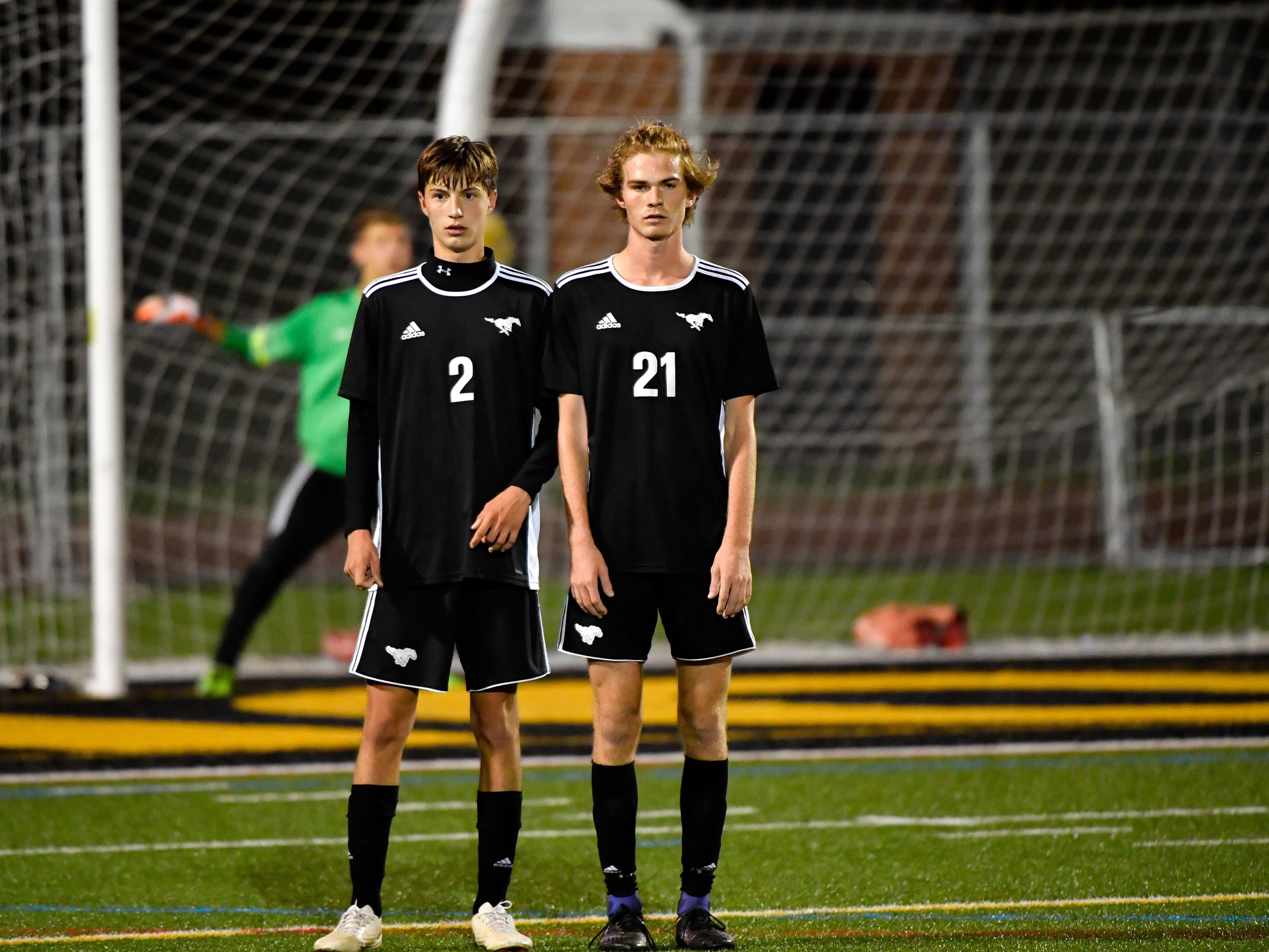 Andrew Baldwin (2) and Colby Winder (21) form a wall to block the free kick during the boys soccer game between South Western and York Catholic, October 16, 2018. The Mustangs beat the Irish 2-1.