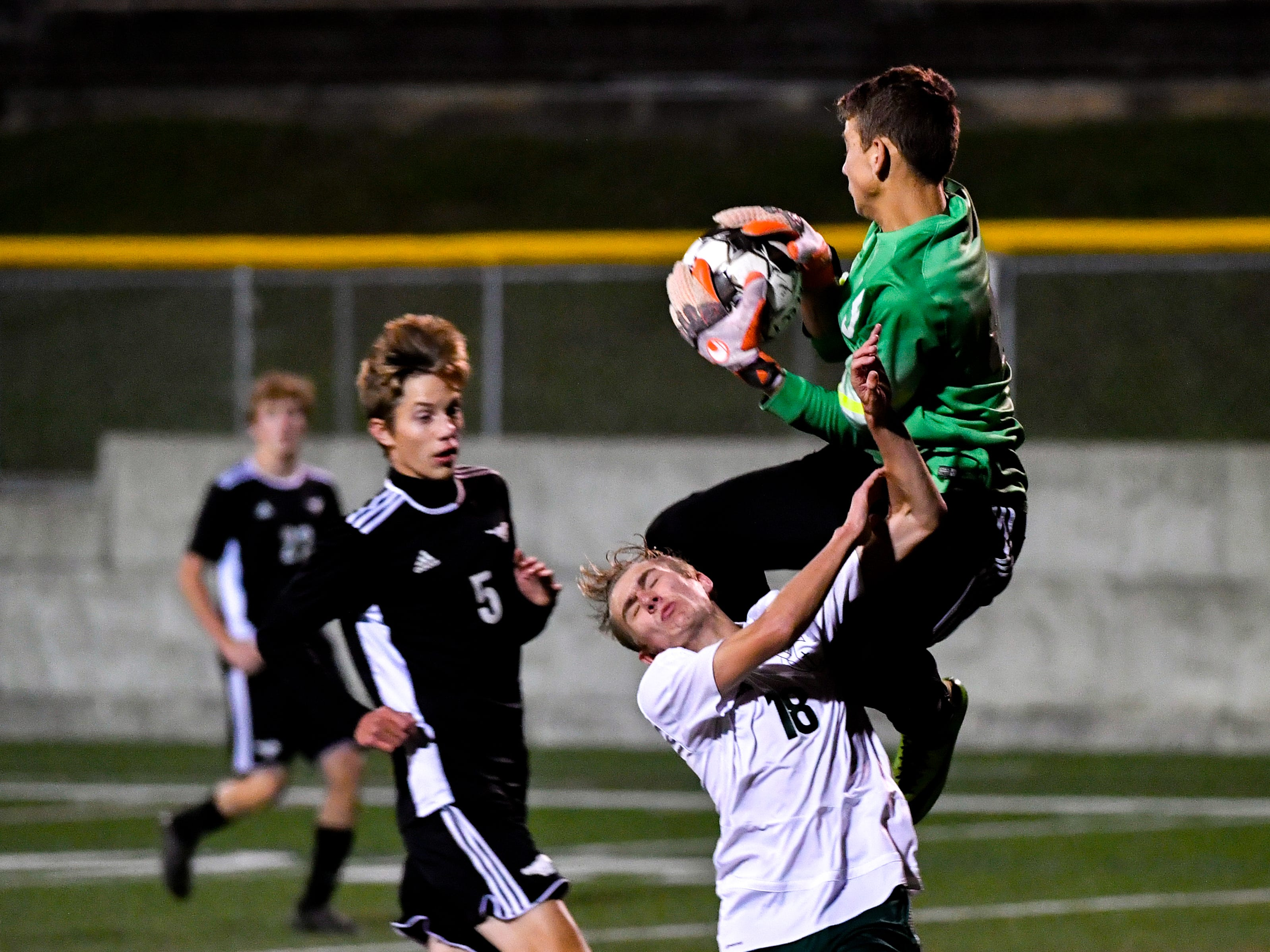 Joe Stevenson (49) of South Western jumps over an attacker to secure the ball during the boys soccer game between South Western and York Catholic, October 16, 2018. The Mustangs beat the Irish 2-1.