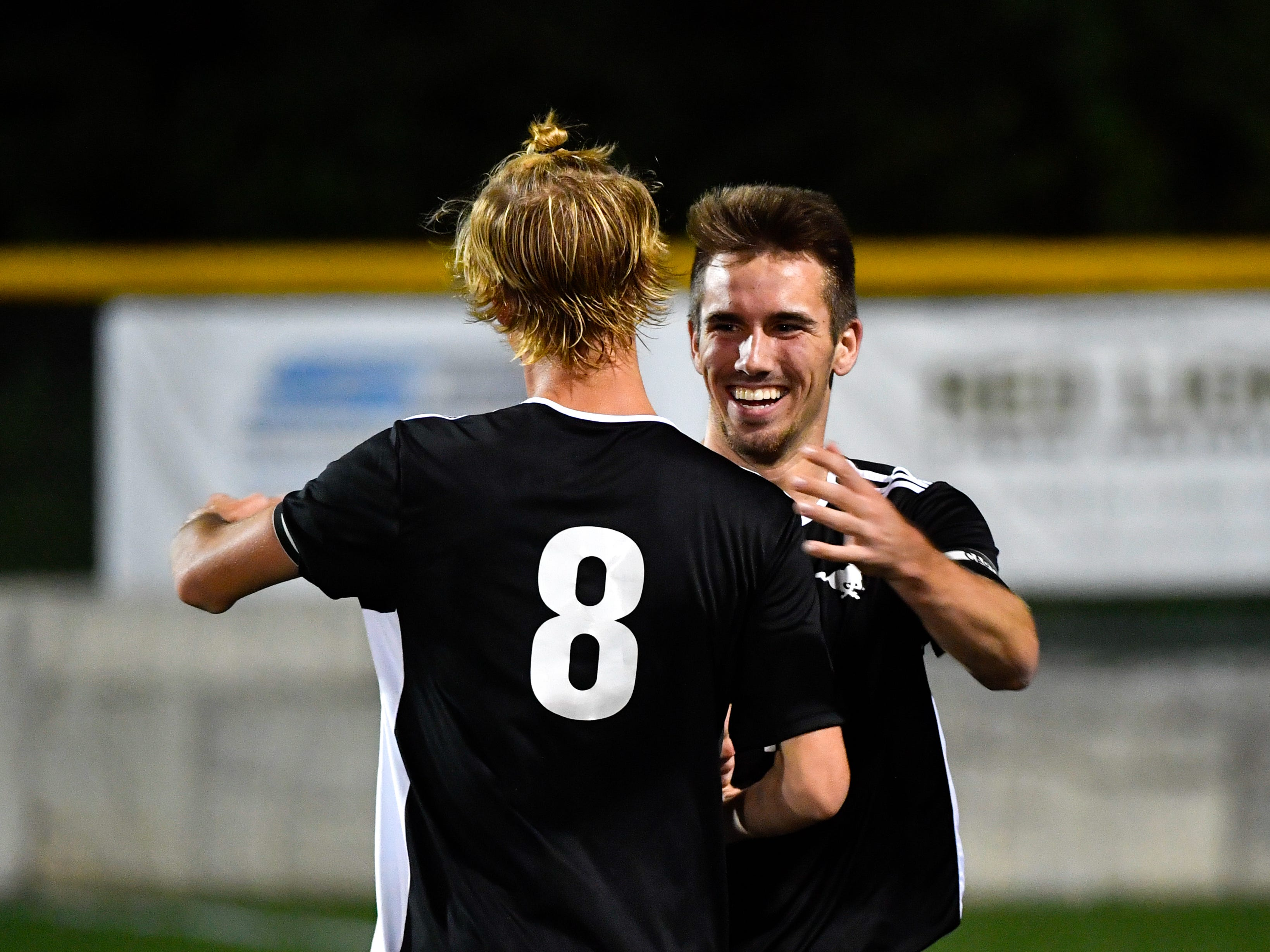 Sean Quinn (7) celebrates his goal with Casey Slater (8) during the boys soccer game between South Western and York Catholic, October 16, 2018. The Mustangs beat the Irish 2-1.