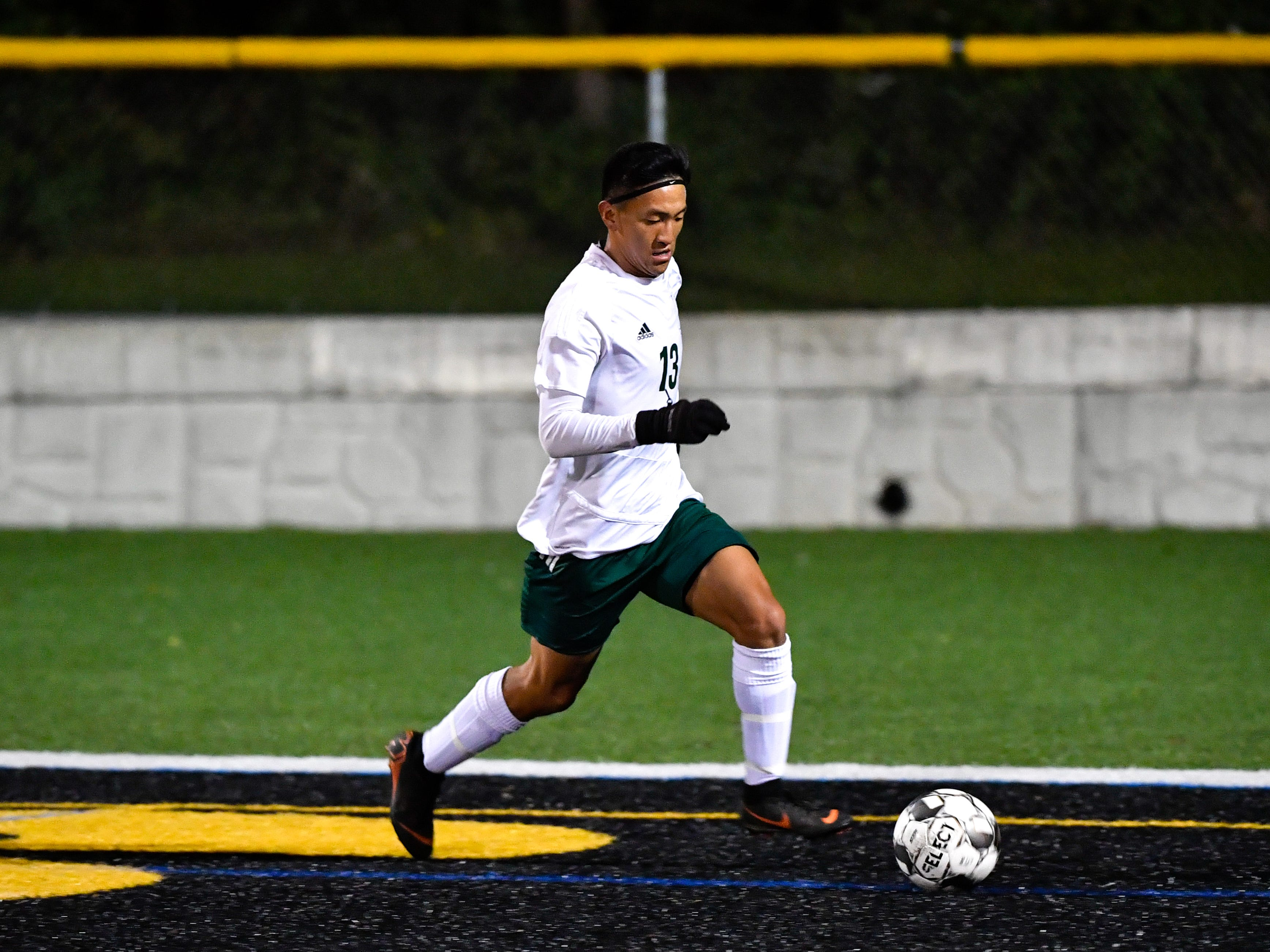 Sean Lavallee (13) of York Catholic takes the ball out of the box during the boys soccer game between South Western and York Catholic, October 16, 2018. The Mustangs beat the Irish 2-1.