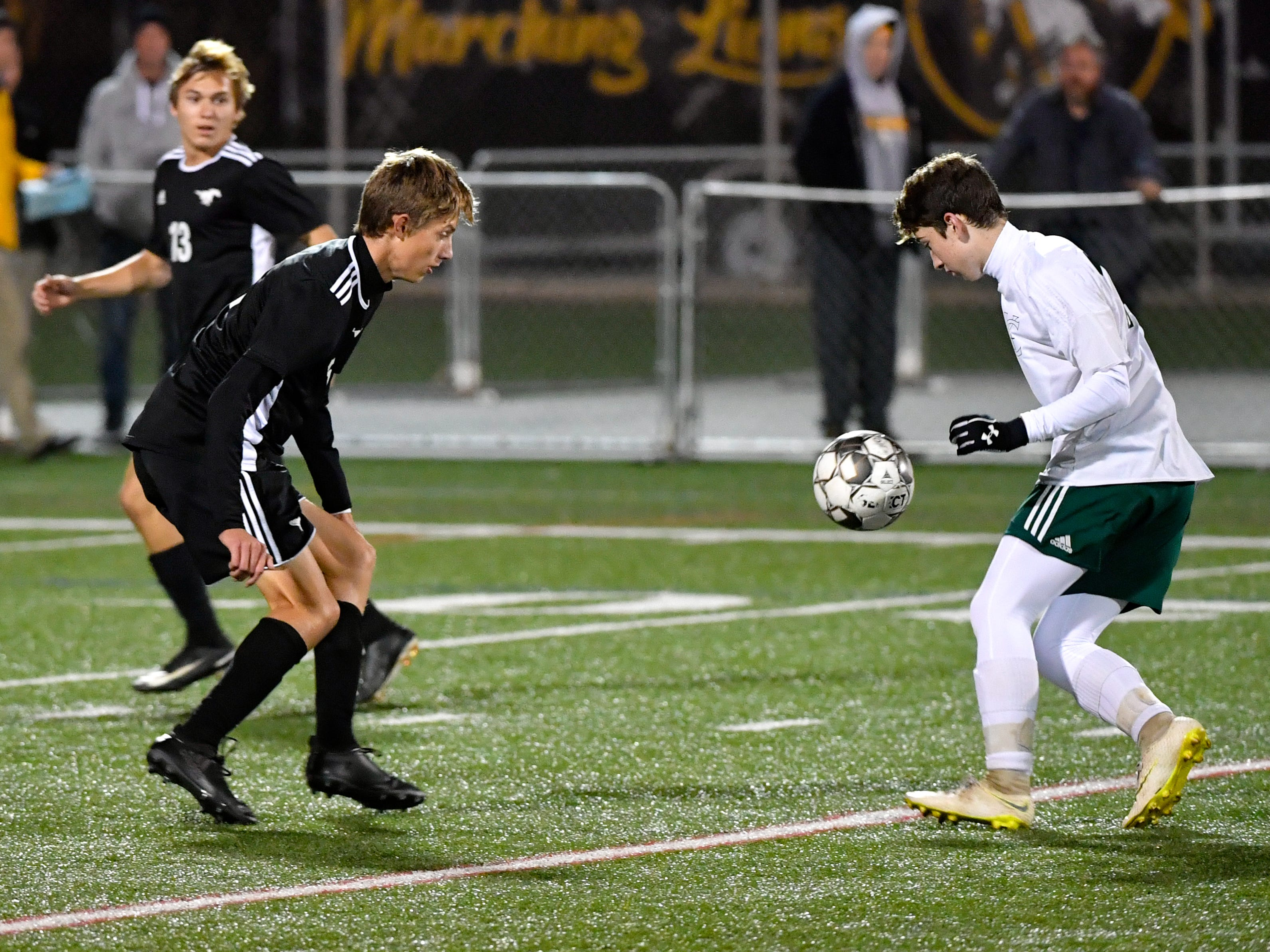 South Western's Dominic Barrett (5), left, defends York Catholic's Dylan Staub (14), right, during the boys soccer game between South Western and York Catholic, October 16, 2018. The Mustangs beat the Irish 2-1.