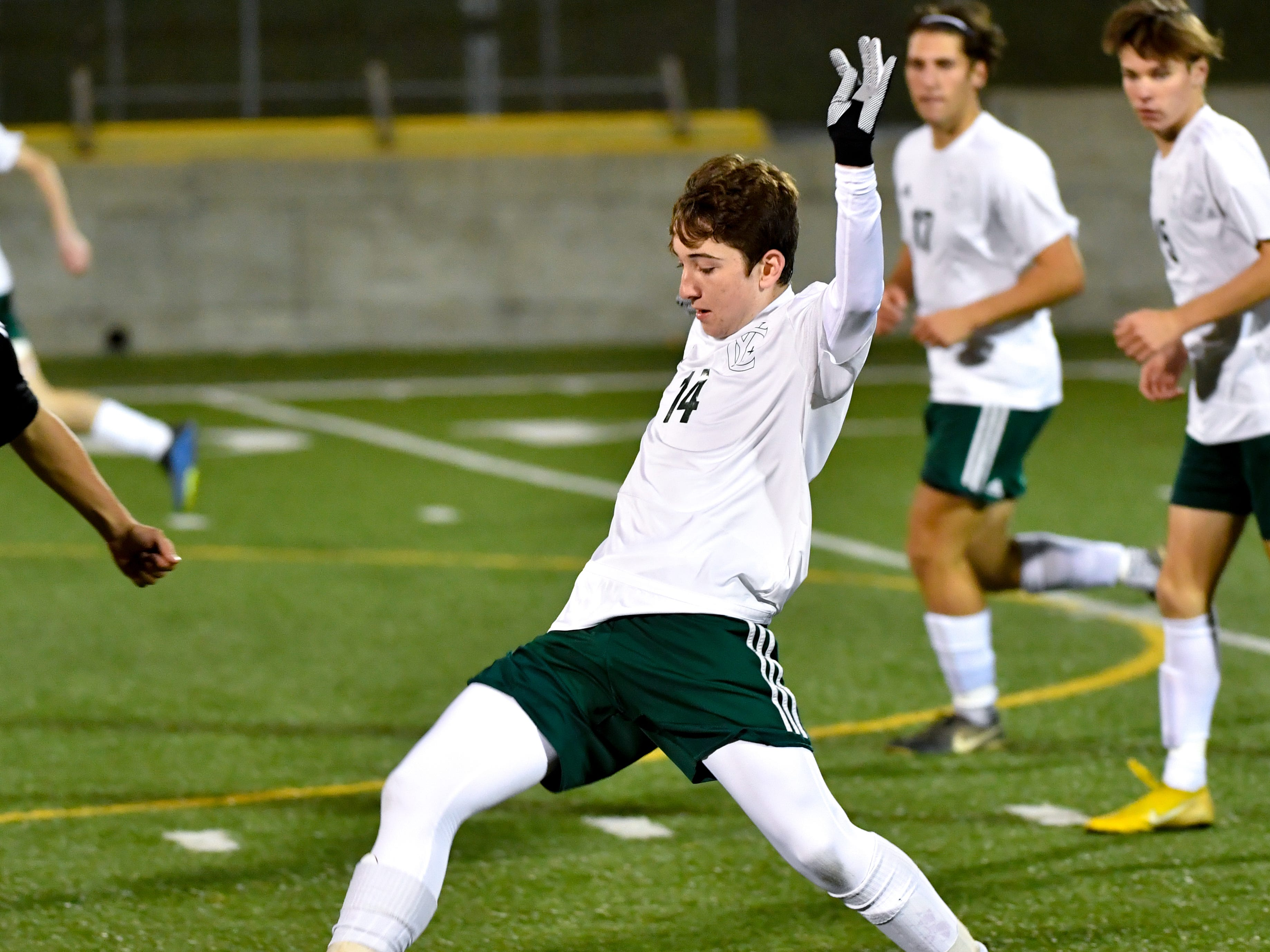 Dylan Staub (14) guides the ball during the boys soccer game between South Western and York Catholic, October 16, 2018. The Mustangs beat the Irish 2-1.