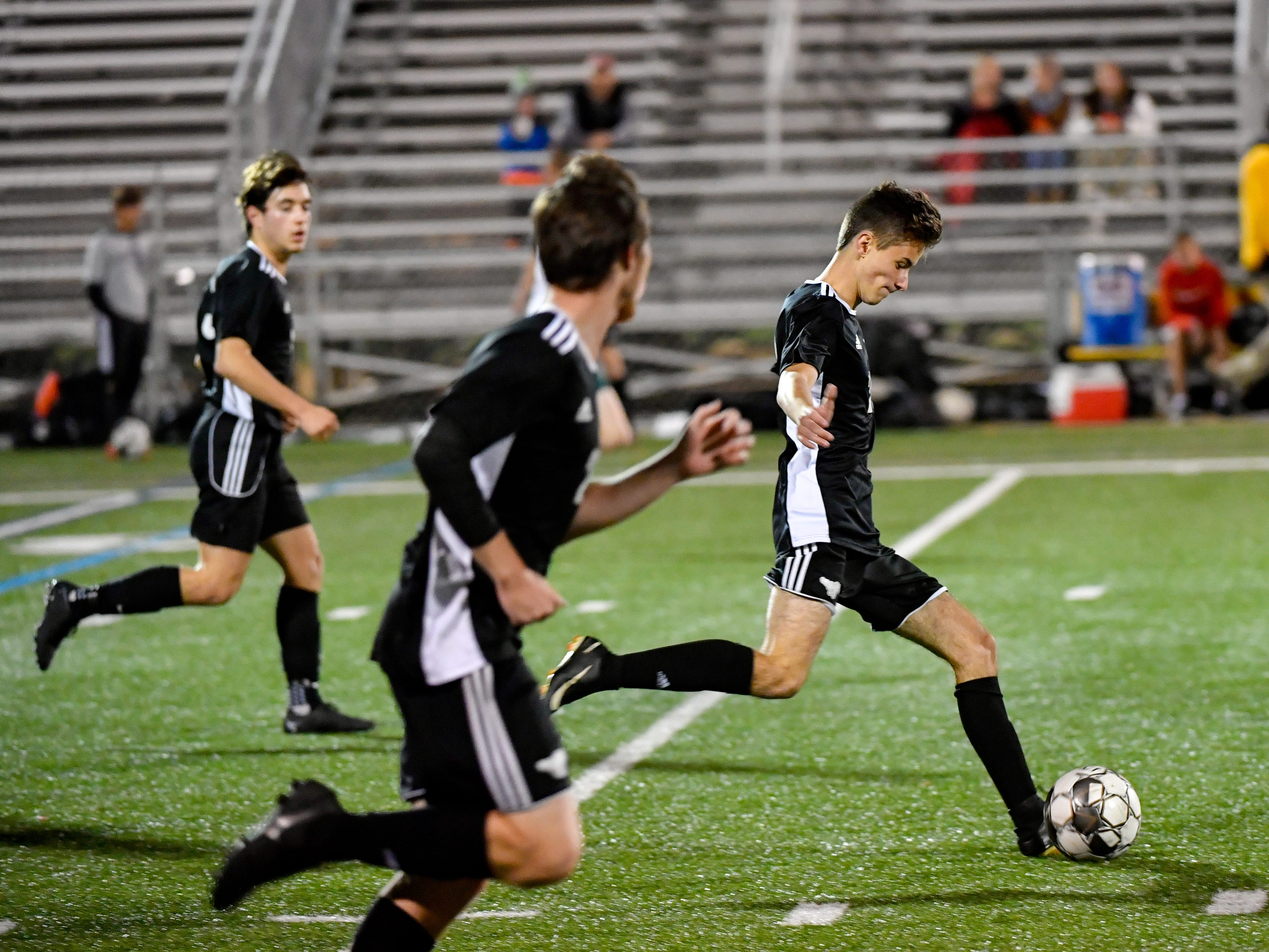 Spencer Wells (29) leads the attack during the boys soccer game between South Western and York Catholic, October 16, 2018. The Mustangs beat the Irish 2-1.