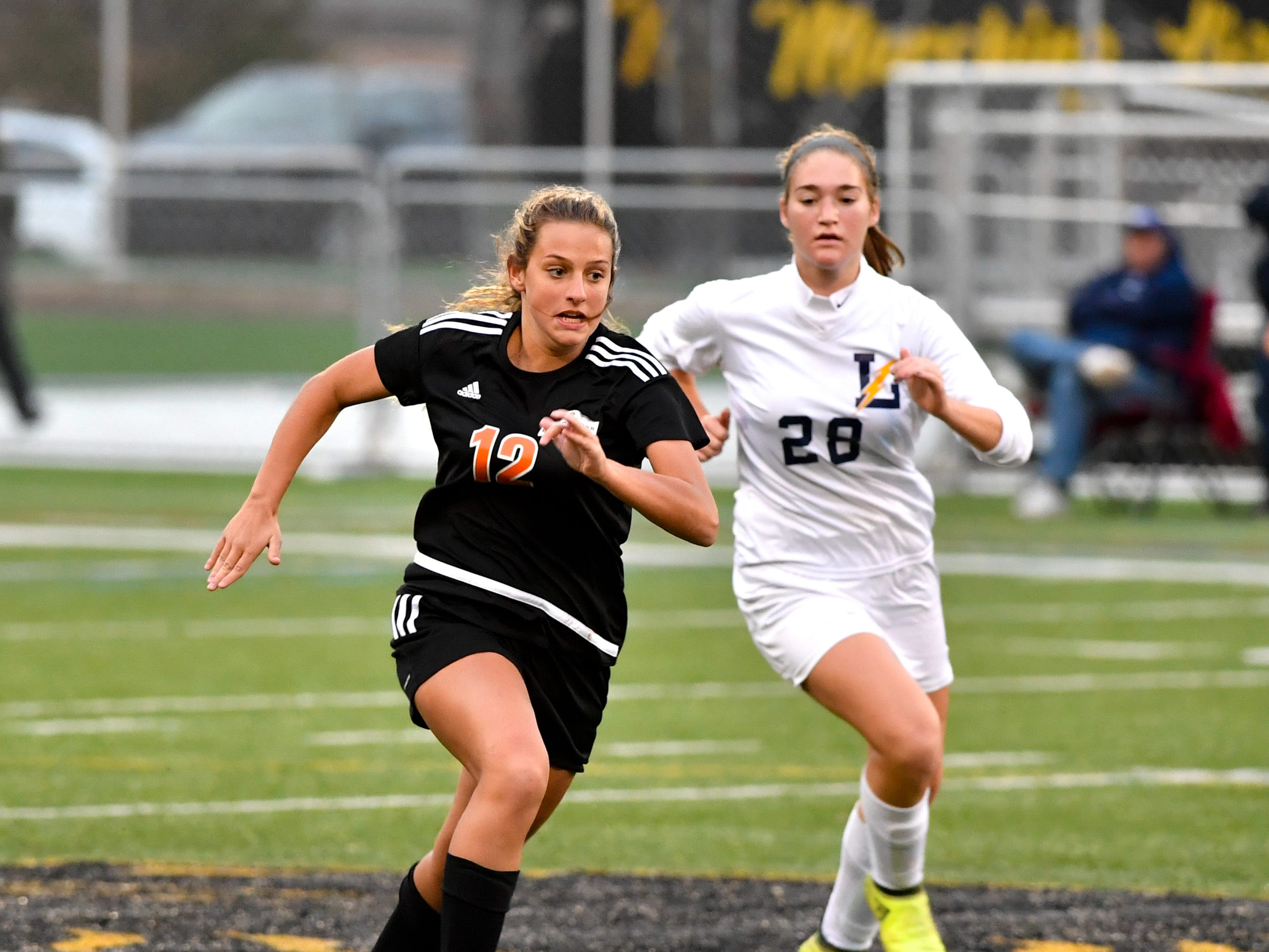 Sophia Yerger (12) of Central York outruns Sydney Miller (28) of Littlestown, October 16, 2018. The Panthers beat the Bolts 6-1.