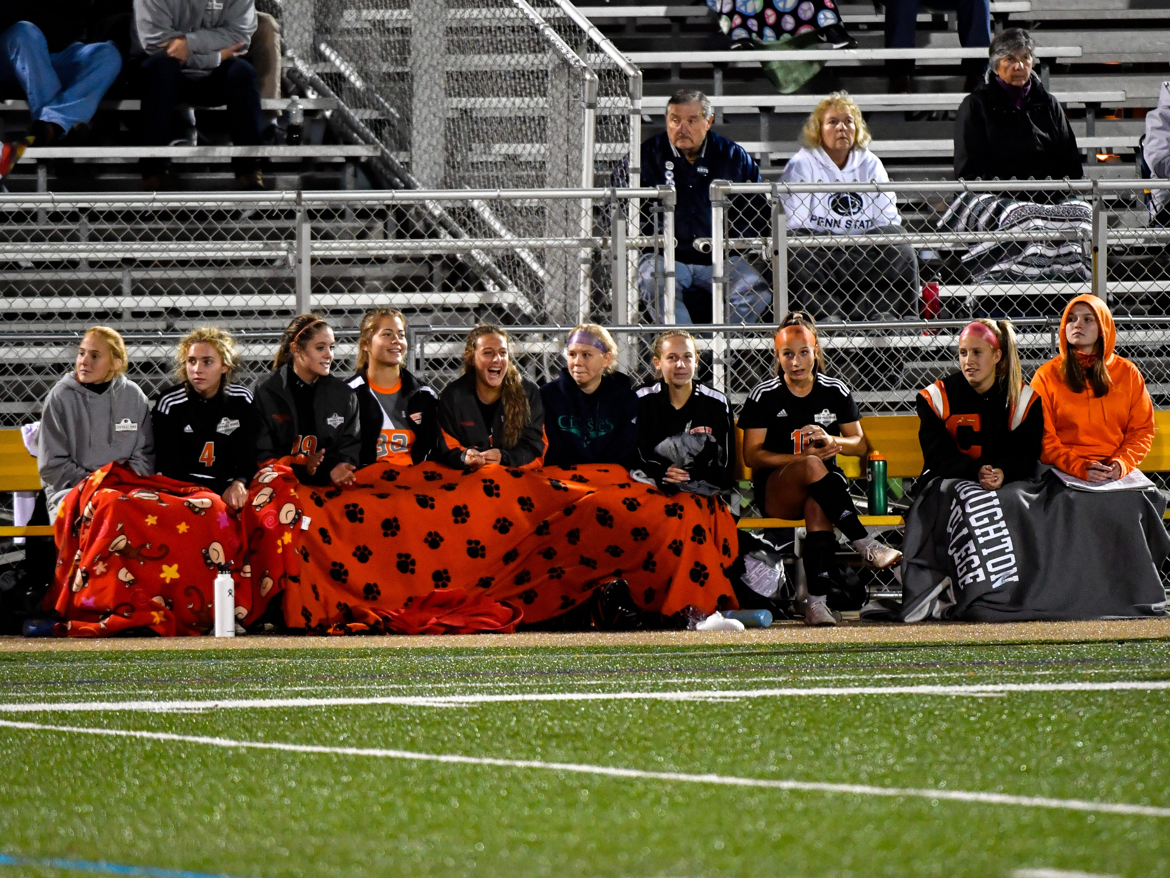 Central York tries to keep warm on the bench during the girls soccer game between Littlestown and Central York, October 16, 2018. The Panthers beat the Bolts 6-1.