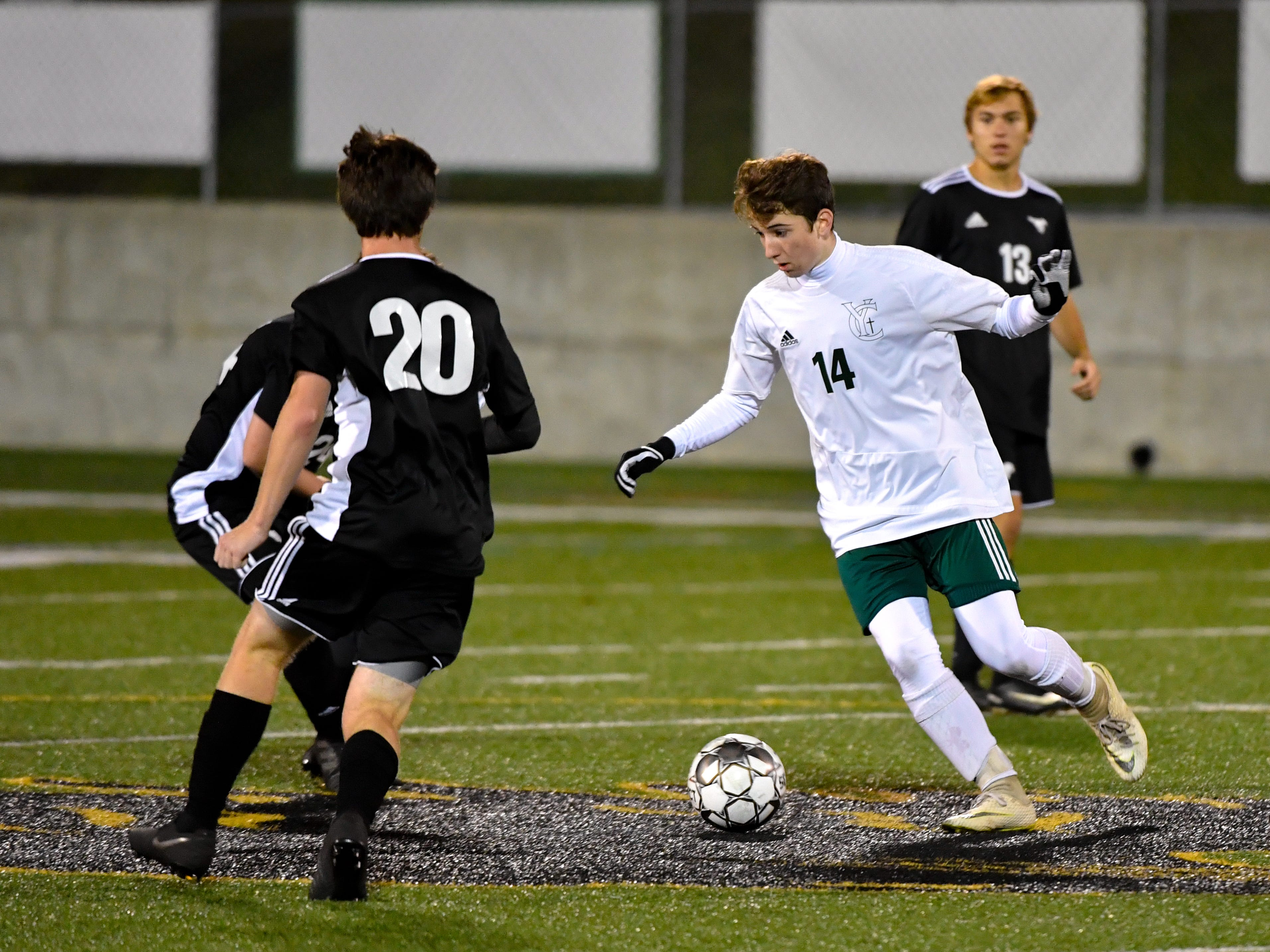 Dylan Staub (14) of York Catholic looks to split the defense during the boys soccer game between South Western and York Catholic, October 16, 2018. The Mustangs beat the Irish 2-1.