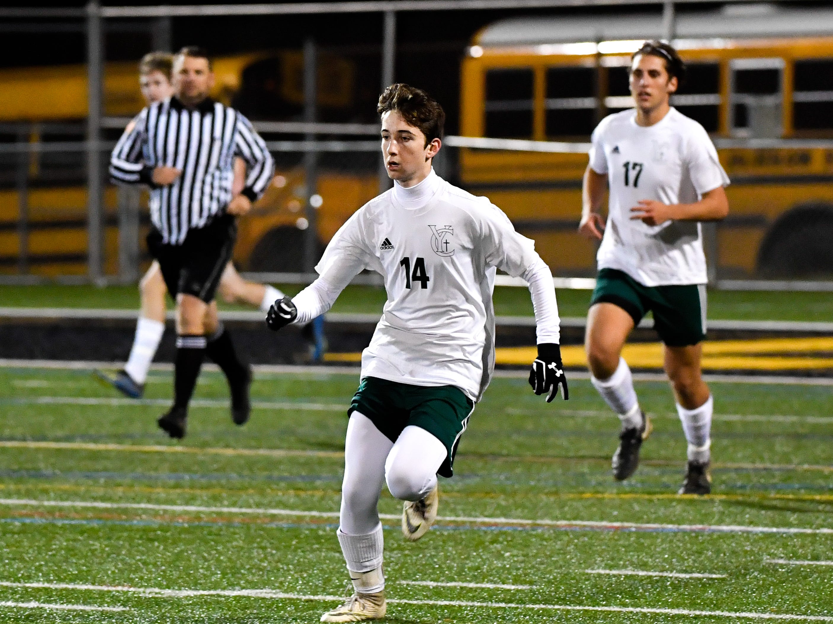 York Catholic's Dylan Staub (14) runs down field during the boys soccer game between South Western and York Catholic, October 16, 2018. The Mustangs beat the Irish 2-1.