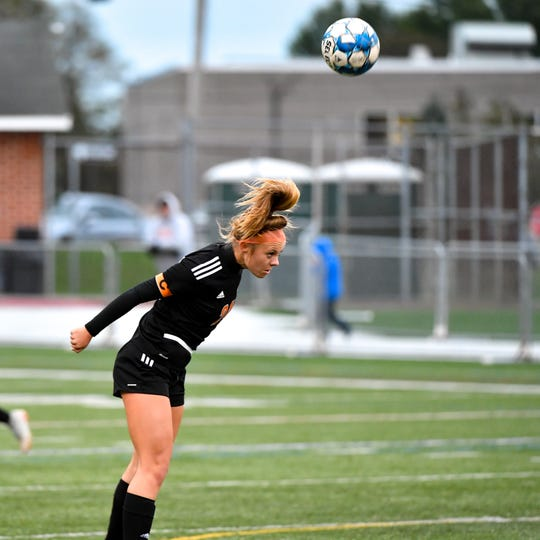 Madi Davis (24) heads the ball away from attackers during the girls soccer game between Littlestown and Central York, October 16, 2018. The Panthers beat the Bolts 6-1.