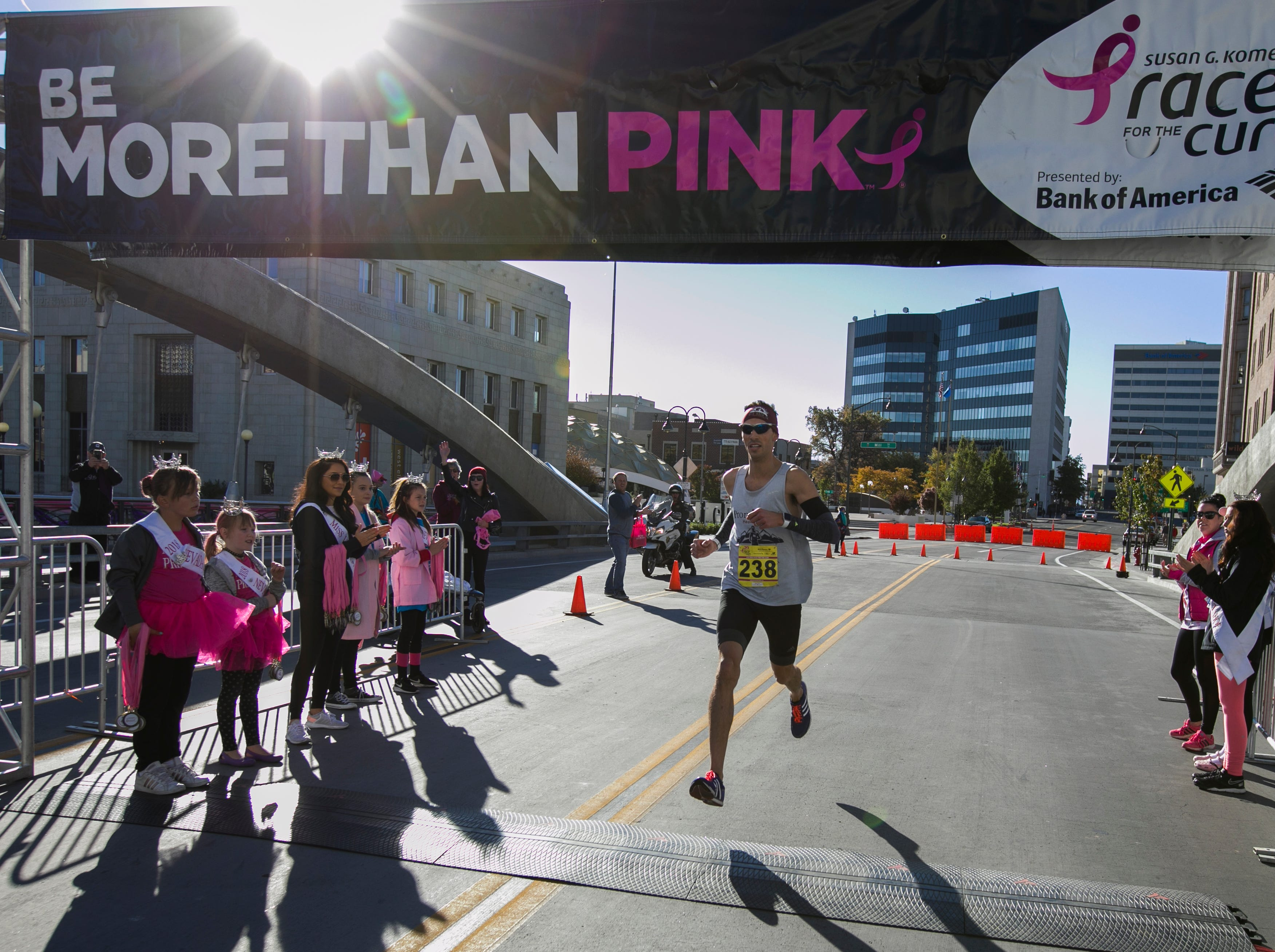 Dominic Henriques won the runners portion of the Susan G. Komen Race for the Cure on Sunday, October 14,  2018 in downtown Reno.
