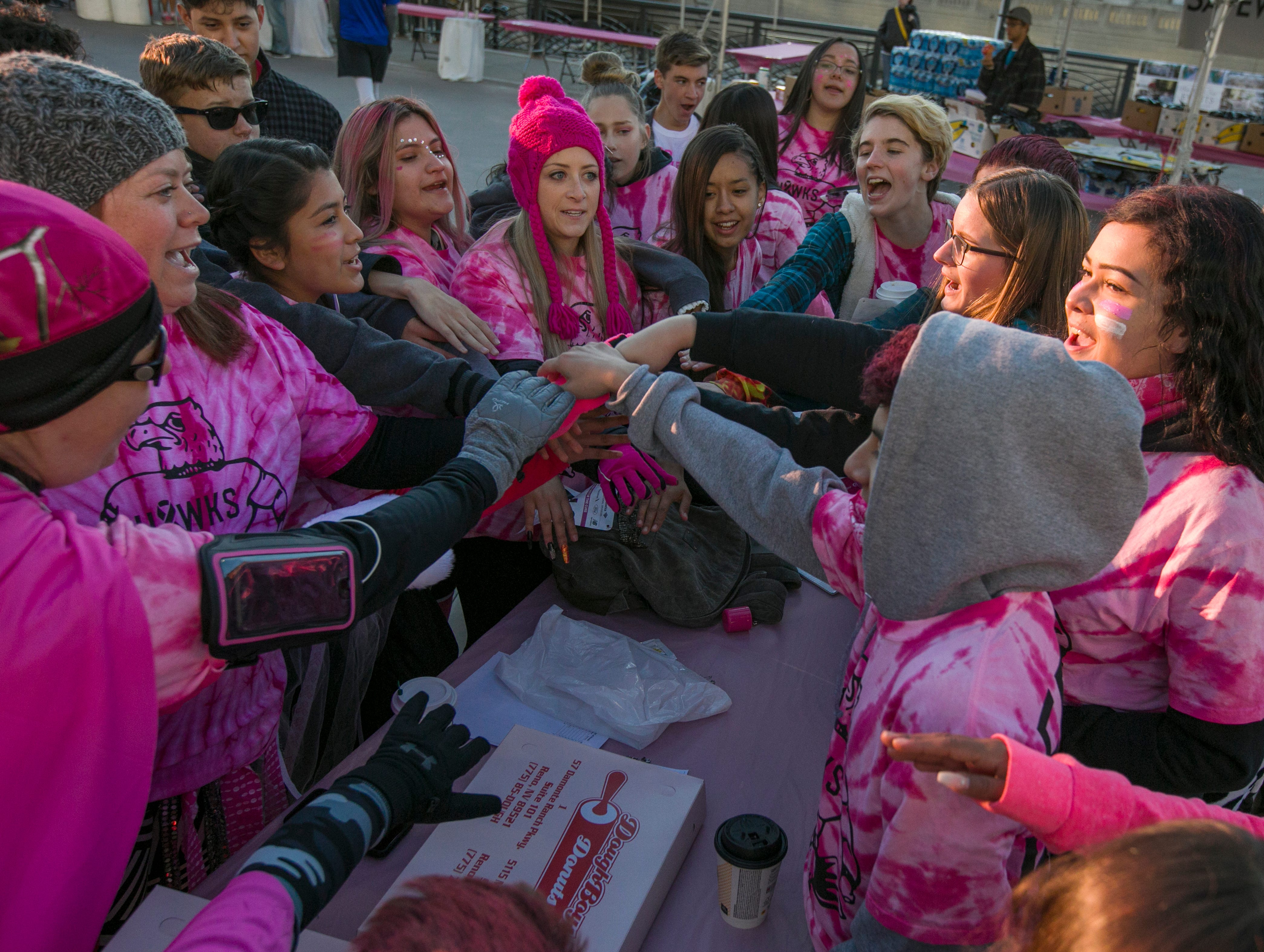 Teams cheer before the start of the Susan G. Komen Race for the Cure on Sunday, October 14,  2018 in downtown Reno.