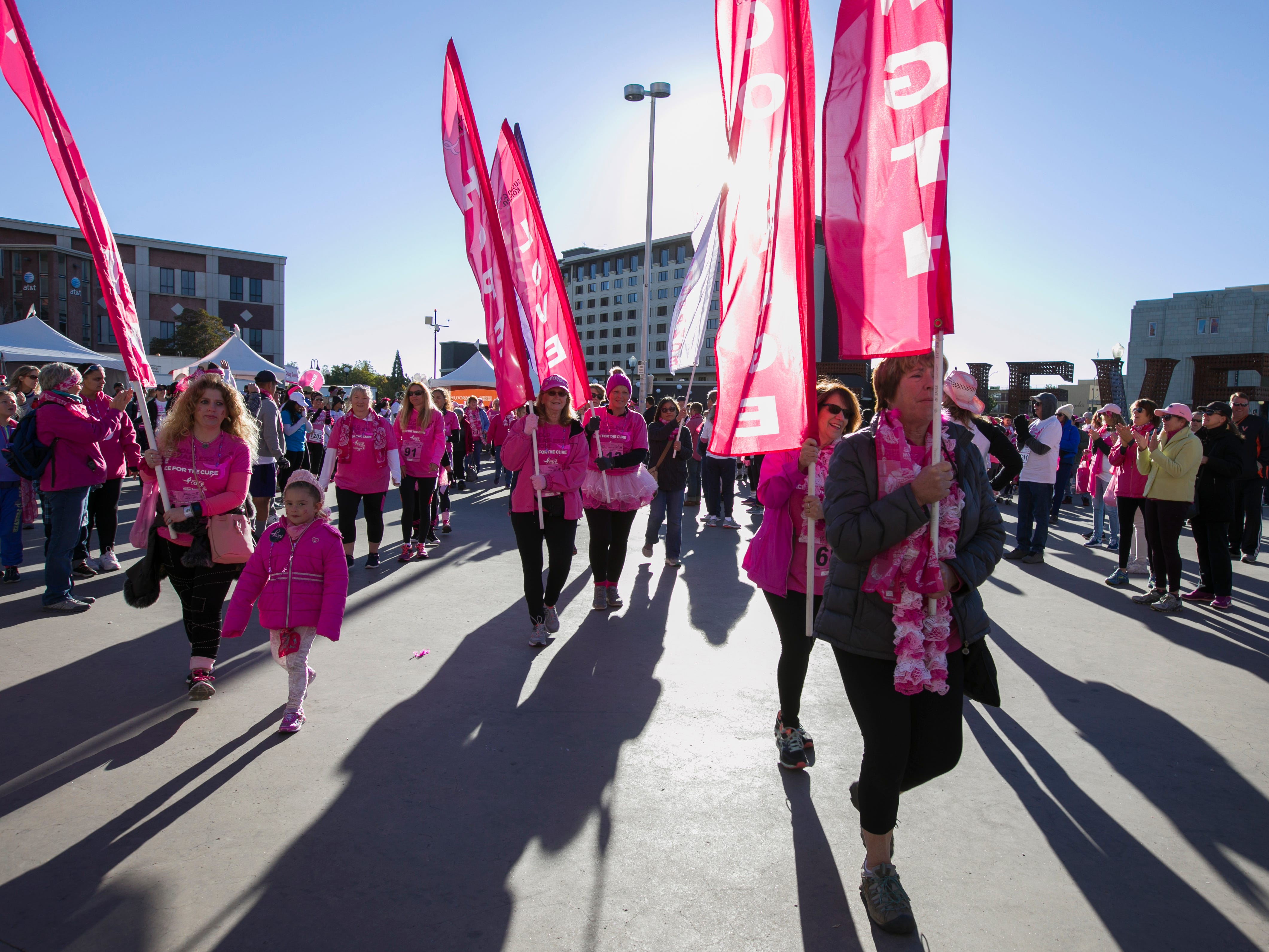 The Survivors Walk before the Susan G. Komen Race for the Cure on Sunday, October 14,  2018 in downtown Reno.
