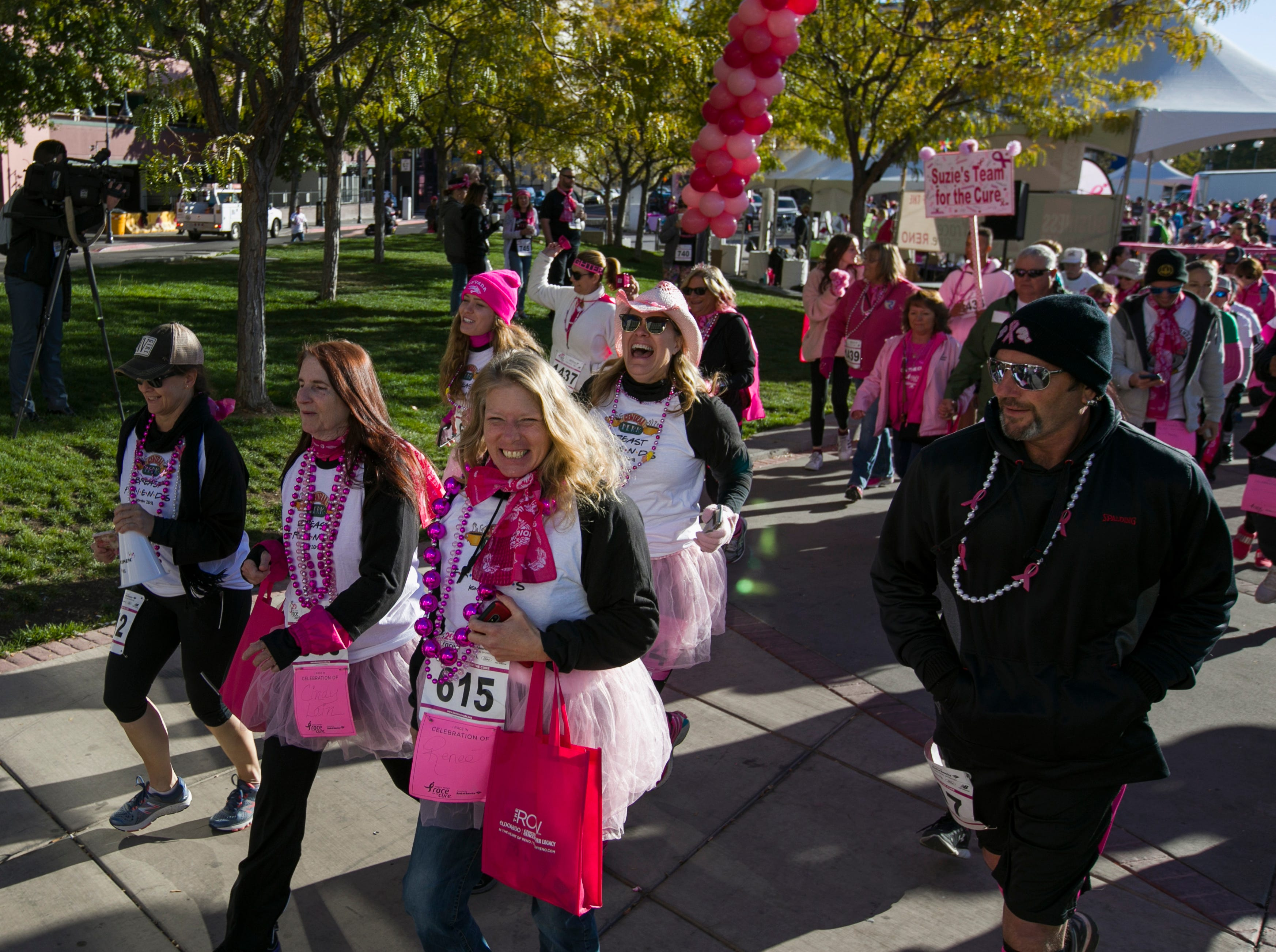 Runners start the Susan G. Komen Race for the Cure on Sunday, October 14,  2018 in downtown Reno.