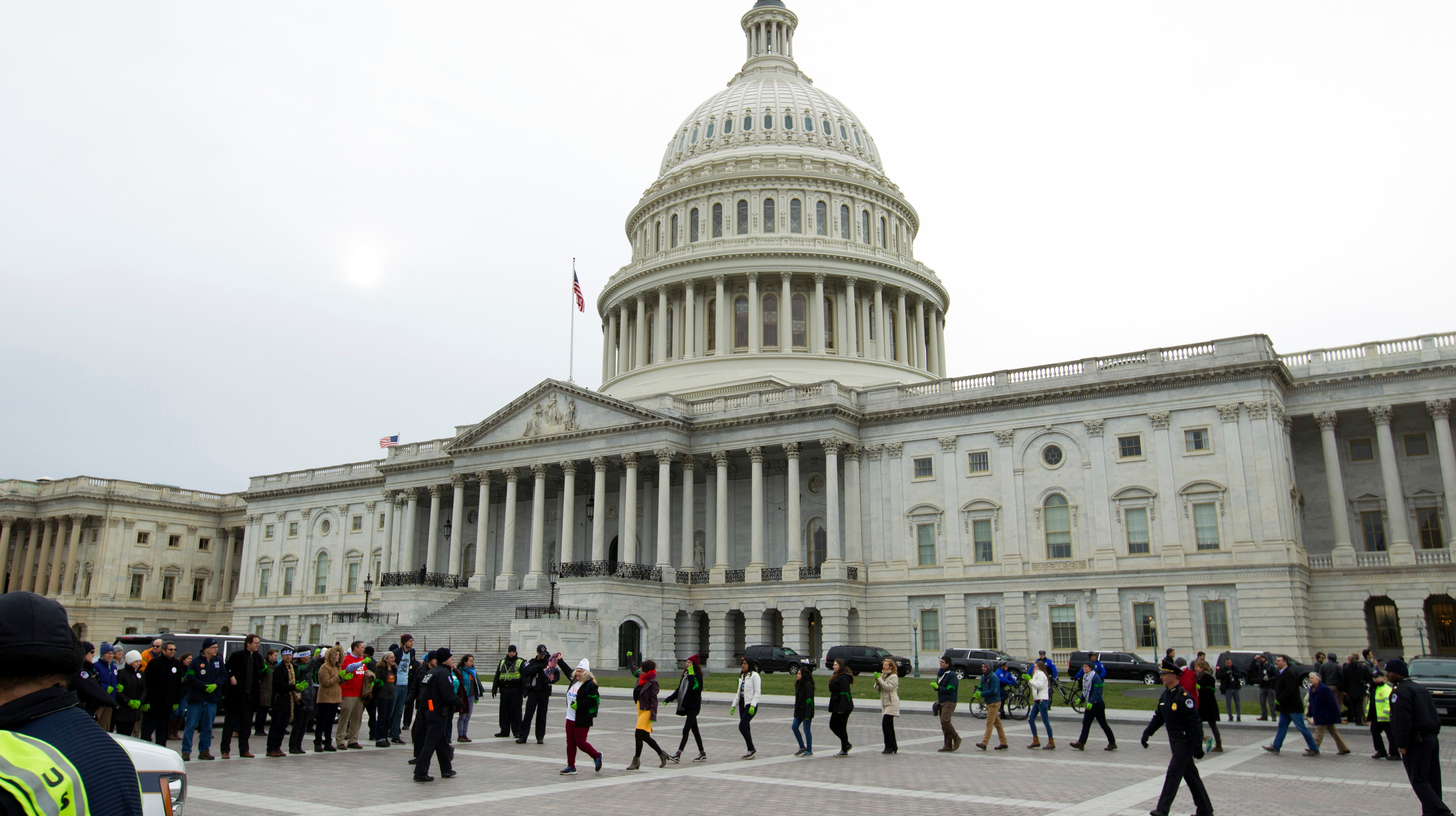 Demonstrators are arrested outside of the U.S. Capitol during an Immigration rally in support of the Deferred Action for Childhood Arrivals (DACA), and Temporary Protected Status (TPS), programs, at Capitol Hill in Washington, Wednesday, Dec. 6, 2017. ( AP Photo/Jose Luis Magana)