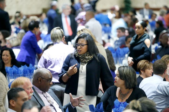Mayor Lovely Warren speaks with attendees during Ibero's 50th anniversary luncheon as part of the 2018 Upstate Latino Summit at the Joseph A. Floreano Riverside Convention Center.