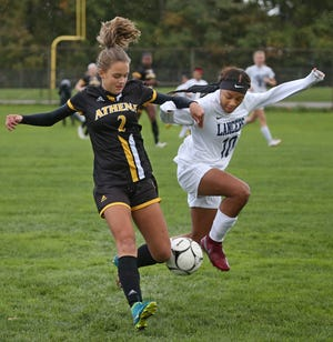 Athena's Kelsey Nugent, left, and Eastridge's Sierra Manning, right, collide as they battle for the ball during their Section V Class A game Wednesday, Oct. 17, 2018 at Greece Athena High School.