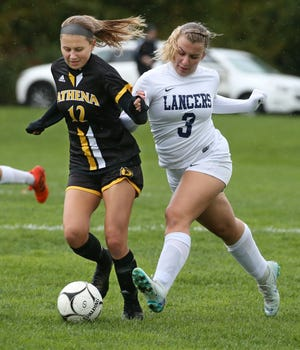 Athena's Kailee Marciano, left, and Eastridge's Kara Taranto battle for the ball during a Section V Class A girls soccer game Wednesday at Athena. The Trojans won, 4-0.
