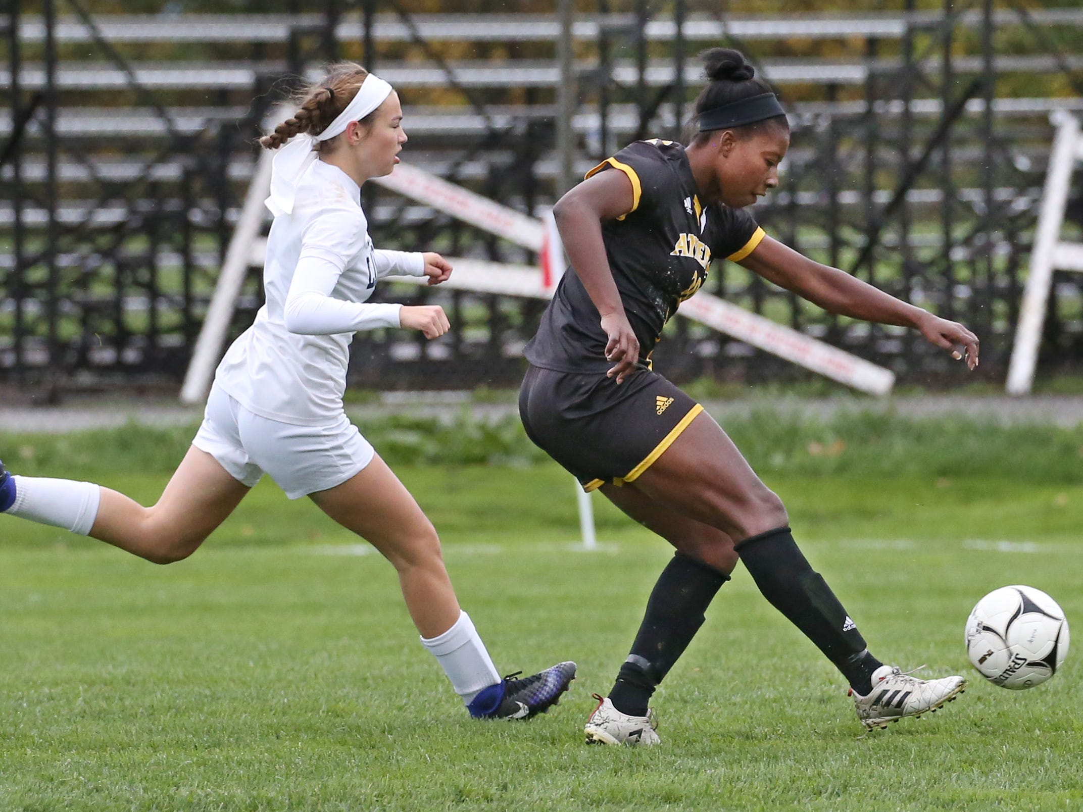 Athena's Waniya Hudson, right, rips her second goal of the game into the net as Eastridge's Jayna Rosati presses.