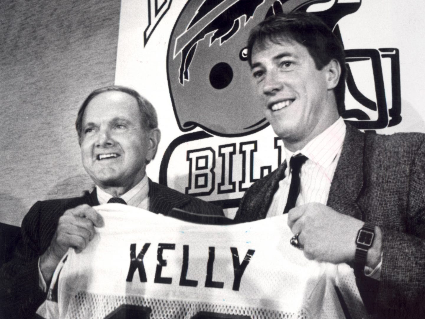 Bills owner Ralph Wilson, left, welcomes his new quarterback, Jim Kelly, to Buffalo in this 1986 photo. Wilson would have turned 100 today (Oct. 17, 2018).