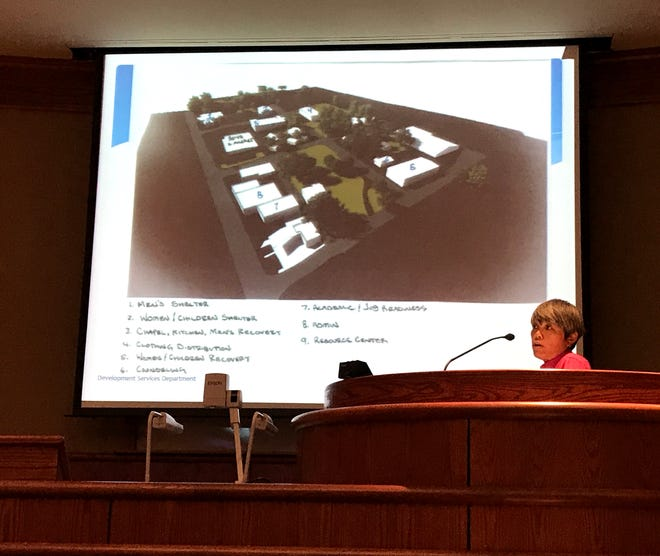 Redding's Interim Planning Manager  Lily Toy describes a use permit application for an indoor commercial cannabis growing facility on South Market Street beside the Good News Rescue Mission during Tuesday night's City Council meeting. The council OK'd the project on a 3-2 vote.