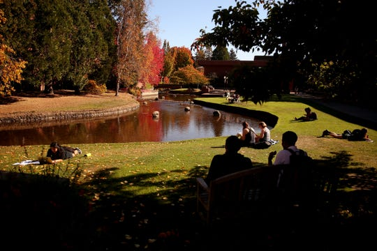 Students gather outside at Willamette University in Salem on Wednesday, Oct. 17, 2018. Tuesday saw a high of 83 degrees in Salem, tying the record set in 2002. Sunshine is expected to continue into the weekend.