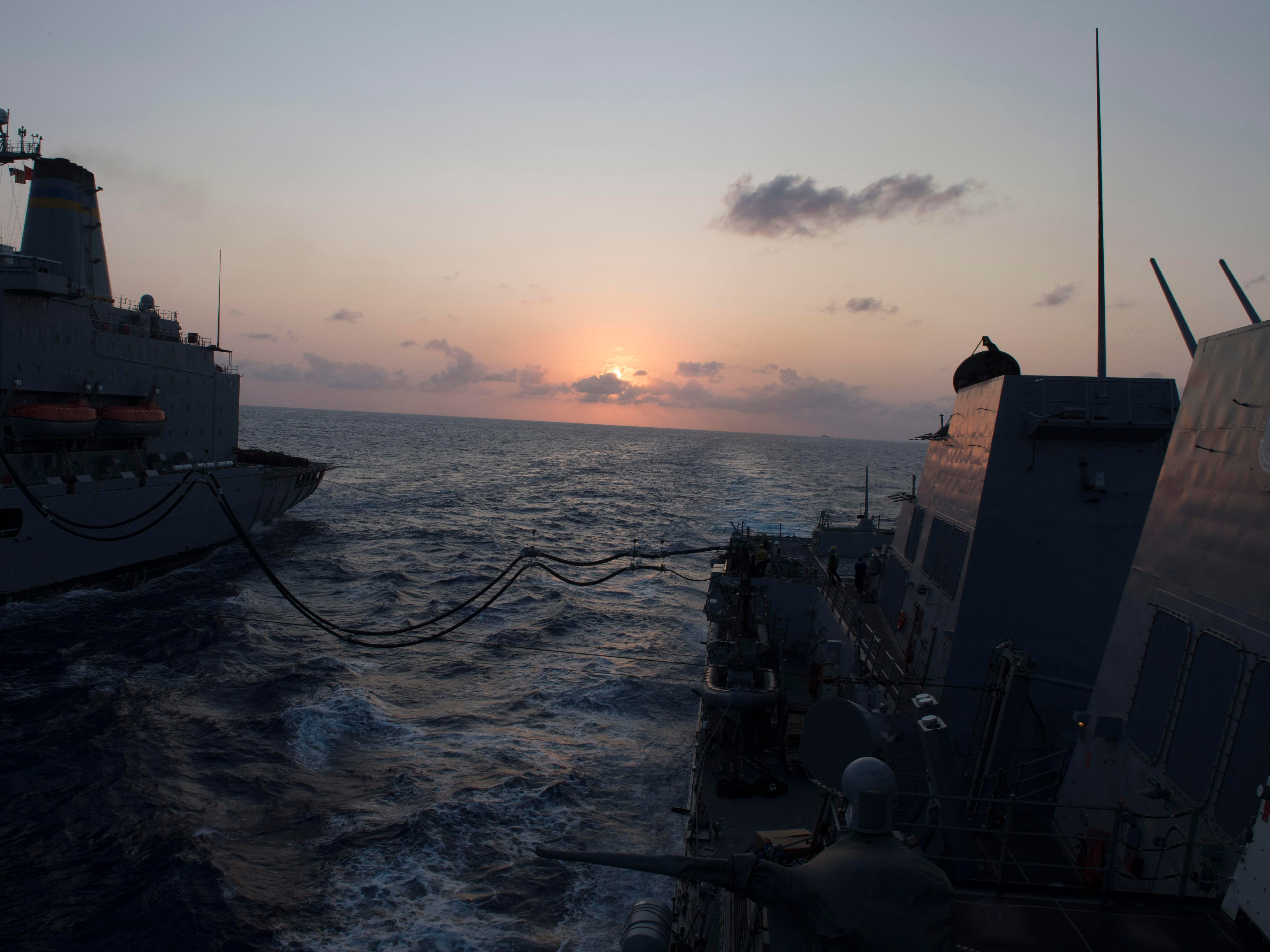 The guided-missile destroyer USS Wayne E. Meyer, commanded by Salem native Jamie Davidson Hopkins, undergoes an Underway Replenishment at Sea.