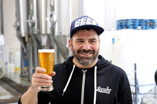 Lardo and Beer O'Clock chef-owner Rick Gencarelli pictured at Gilgamesh Brewin witha  pint of Pig Out, a collaboration beer.