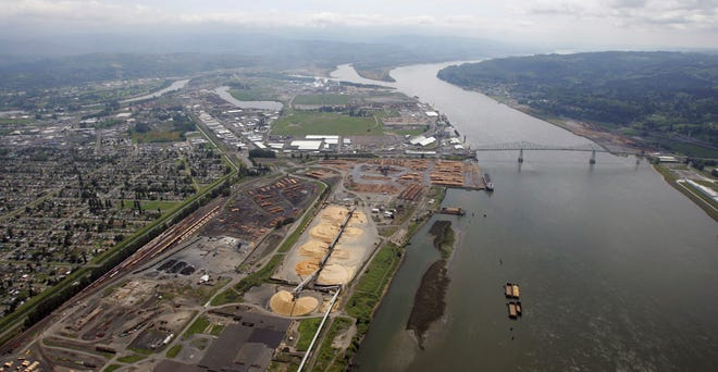 In this May 12, 2005, file photo, timber-processing facilities line the banks of the Columbia River near the Port of Longview in Longview, Wash.