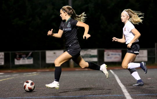 West Salem's Jillian Huhn protects the ball on Tuesday, Oct. 16 at West Salem High School. The team is currently tied for first place in the Mountain Valley Conference