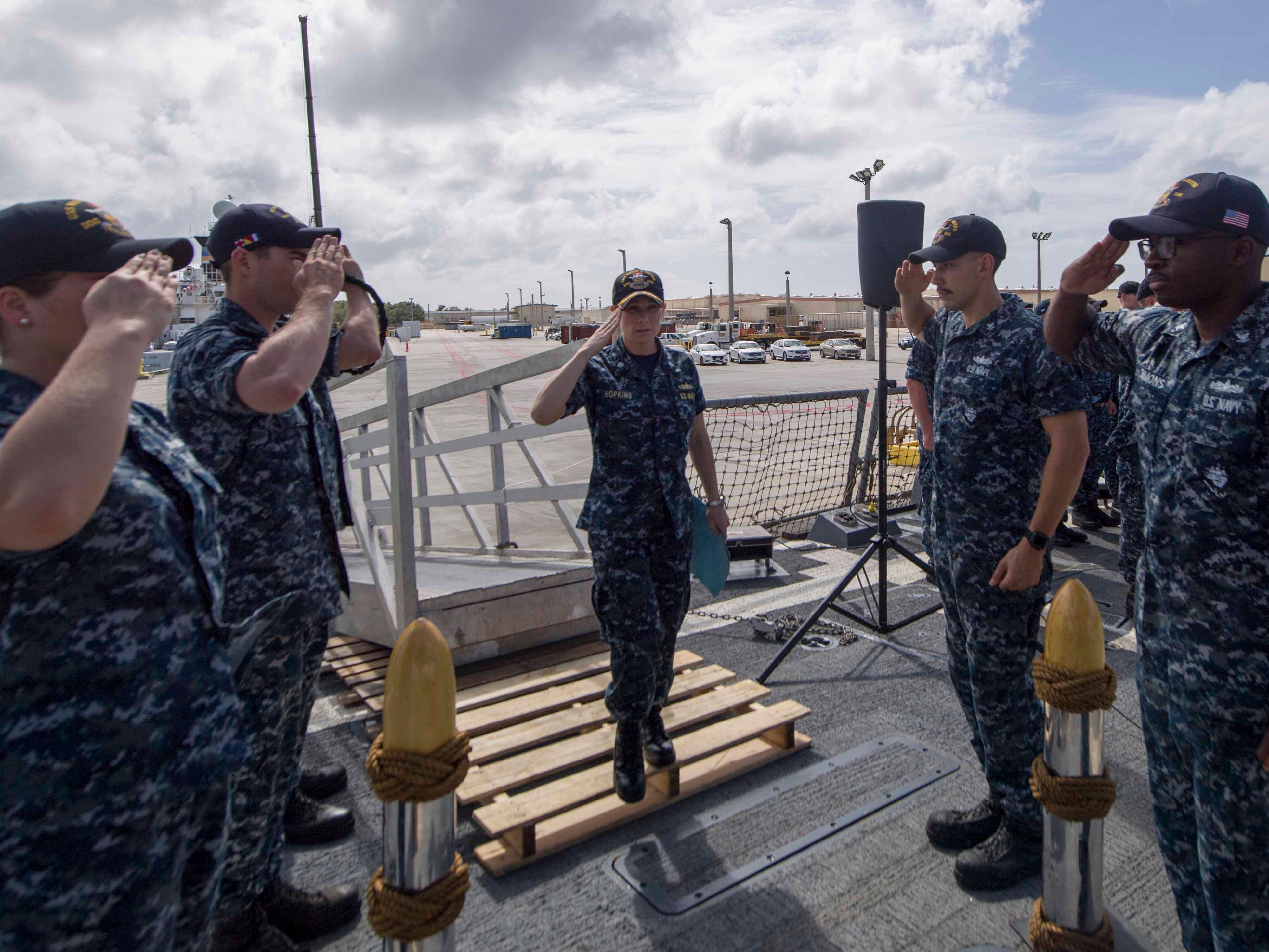 Cmdr. Jamie Davidson Hopkins, center, sales crew members during a change of command ceremony Jan. 31, 2018 on the Arleigh Burke-class guided-missile destroyer USS Wayne E. Meyer.