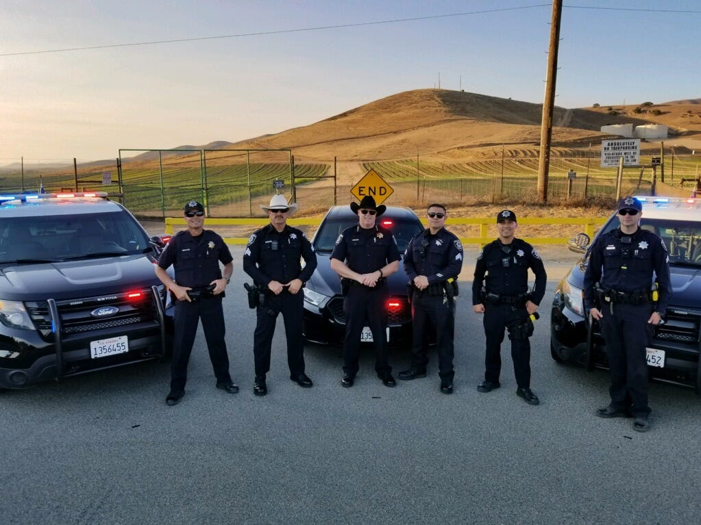 Members of the Soledad Police Department pose for a photo while filming their lip sync challenge video.