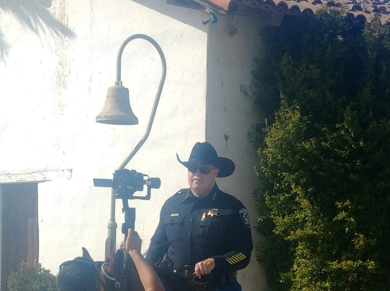 Soledad Police Chief Eric C. Sills rides a horse while filming part of the police department's lip sync challenge video.