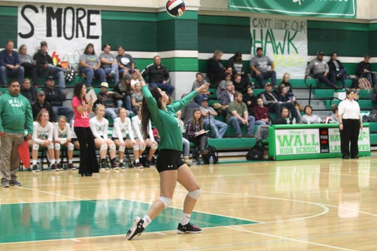 Wall's Candra Barnett serves the ball to Grape Creek in a District 4-3A volleyball match Tuesday, Oct. 16, 2018, at Wall.