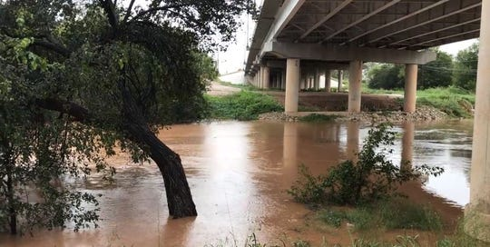 The Colorado River flows out of its banks near Ballinger, Texas, on Wednesday, Oct. 17, 2018.