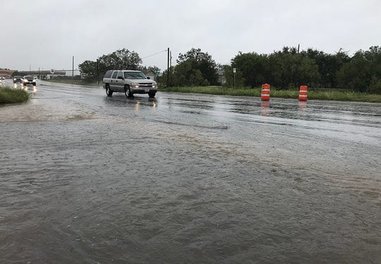 Orange cones are up in front of the Red Arroyo on south Jackson Street Wednesday, Oct. 17, 2018 as rainfall causes minor flooding.