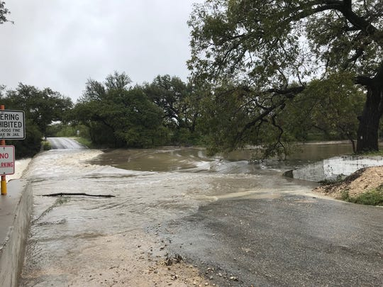 Spring Creek overflows Brim's Crossing near Mertzon on Wednesday, Oct. 17, 2018. Frequent rains have added up, with more than 14 inches of rain falling in an 8-day period.