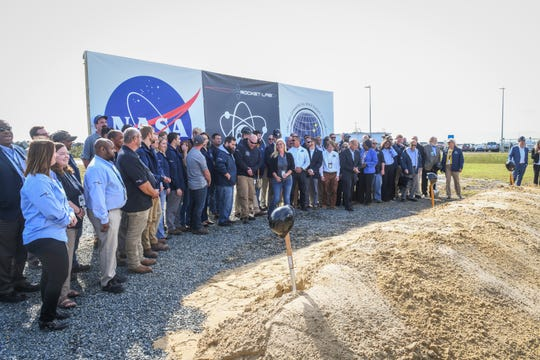 Space industry and political leaders pose after breaking ground at the new Rocket Lab launch complex on NASA's Wallops Island on Wednesday, Oct 17, 2018.