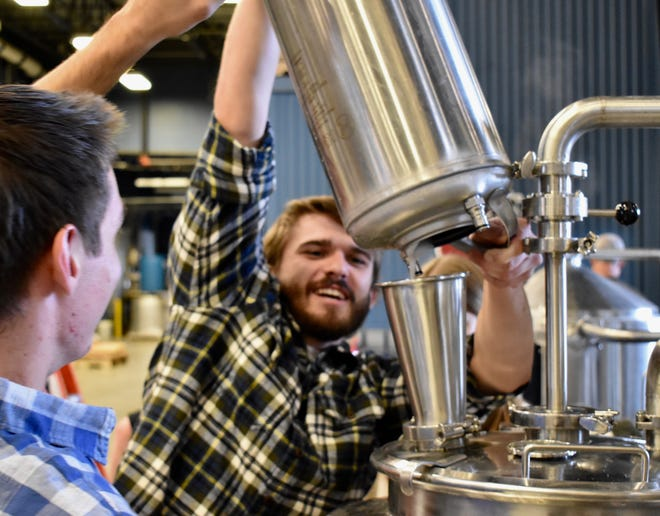 UW-Madison students adding wild lager yeast to the beer recipe. The Wild Lager was first discovered in 2011 in Argentina but has now been discovered for the first time in Sheboygan.