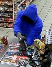 A suspect wanted in the robbery at the Raceway in the 2100 block of Old Minden Road.