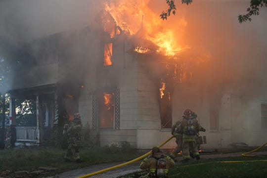 Firefighters respond to a blaze at the corner of Douglas Avenue and Nichols Street in Springfield.