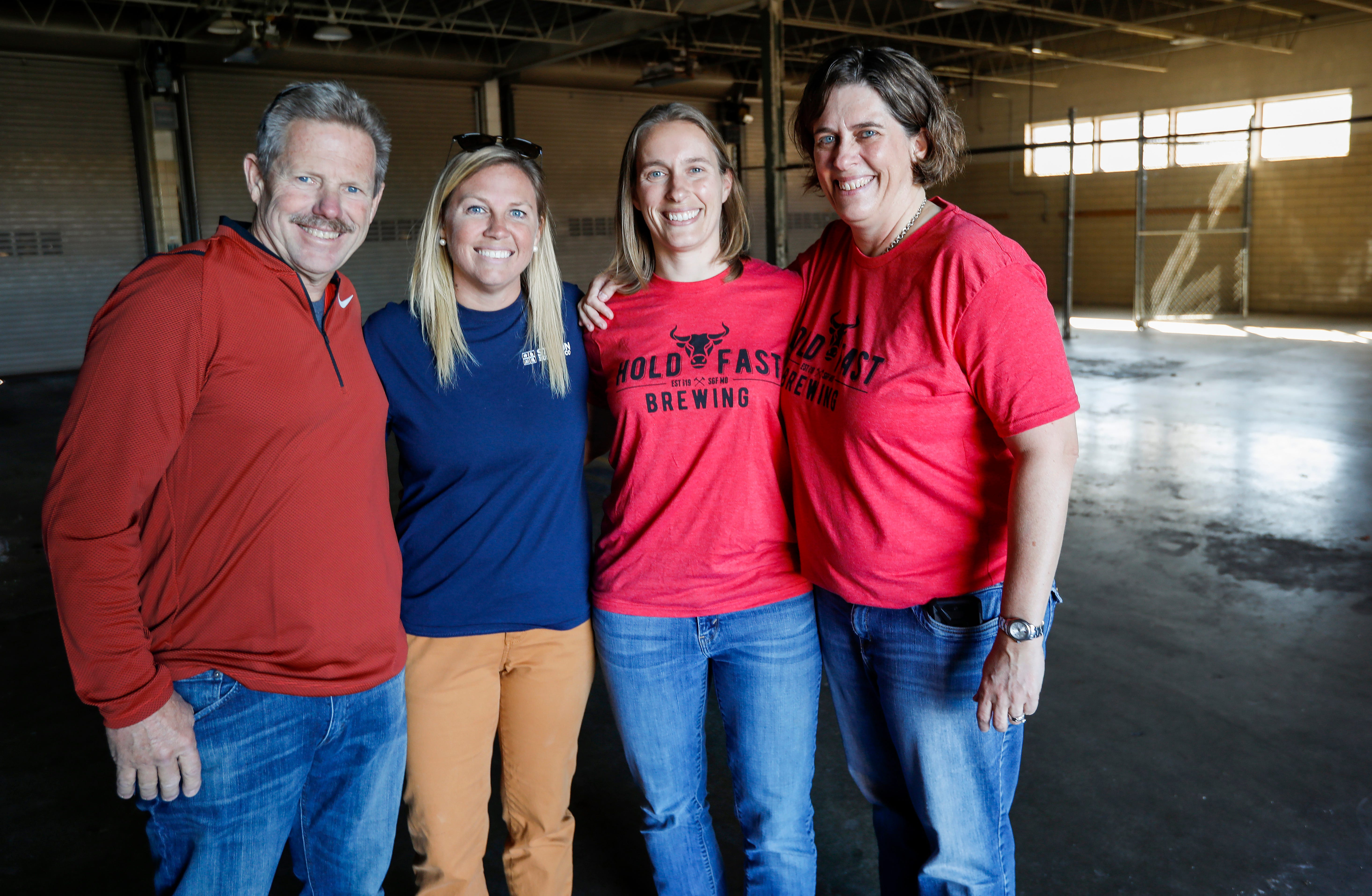 From left, Jack Stinson, Natalee Stinson, Susan McLeod and Carol McLeod stand inside the future home of Hold Fast Brewing on Wednesday, Oct. 17, 2018. The new brewery will be located at the intersection of Kimbrough Avenue and Trafficway Street inside an old firehouse and is expected to open in the summer of 2019.