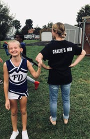 Gracie Jones, 10, a cheerleader for Fort Defiance's Augusta County Quarterback Club junior team.