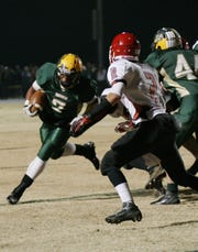 Wilson's Malik Rucks runs the ball against Riverheads in a playoff game at Wilson Memorial on Friday, November 16, 2012.