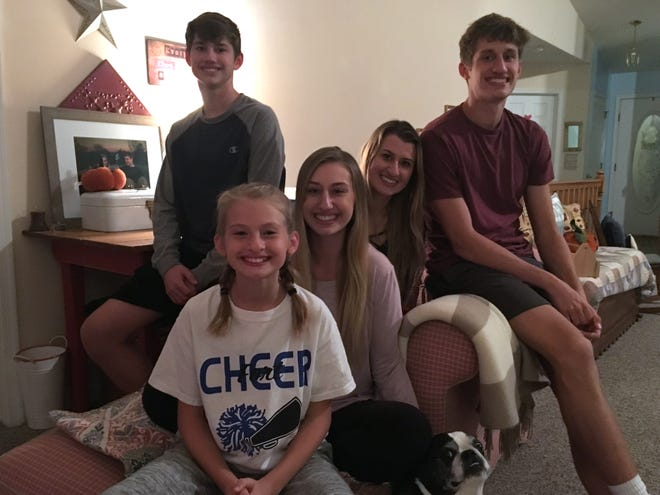 From top left, clockwise, Josh, Sara, Jacob, Madison and Gracie Jones. Marley Jones, the family's Bugg (a cross between a Boston Terrier and Pug) joined the photo.