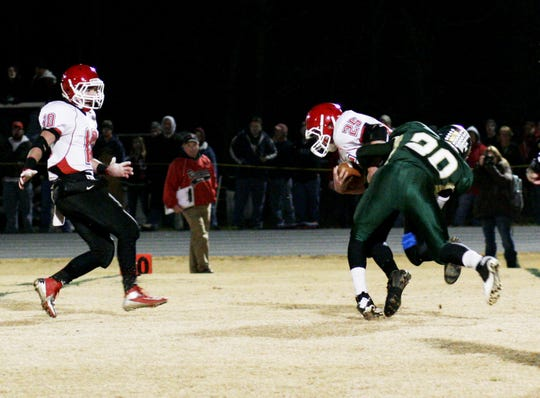 Riverheads' Kyle Wilson gets tackled by Wilson's Thai Wright (right) in a playoff game at Wilson Memorial on Friday, November 16, 2012.