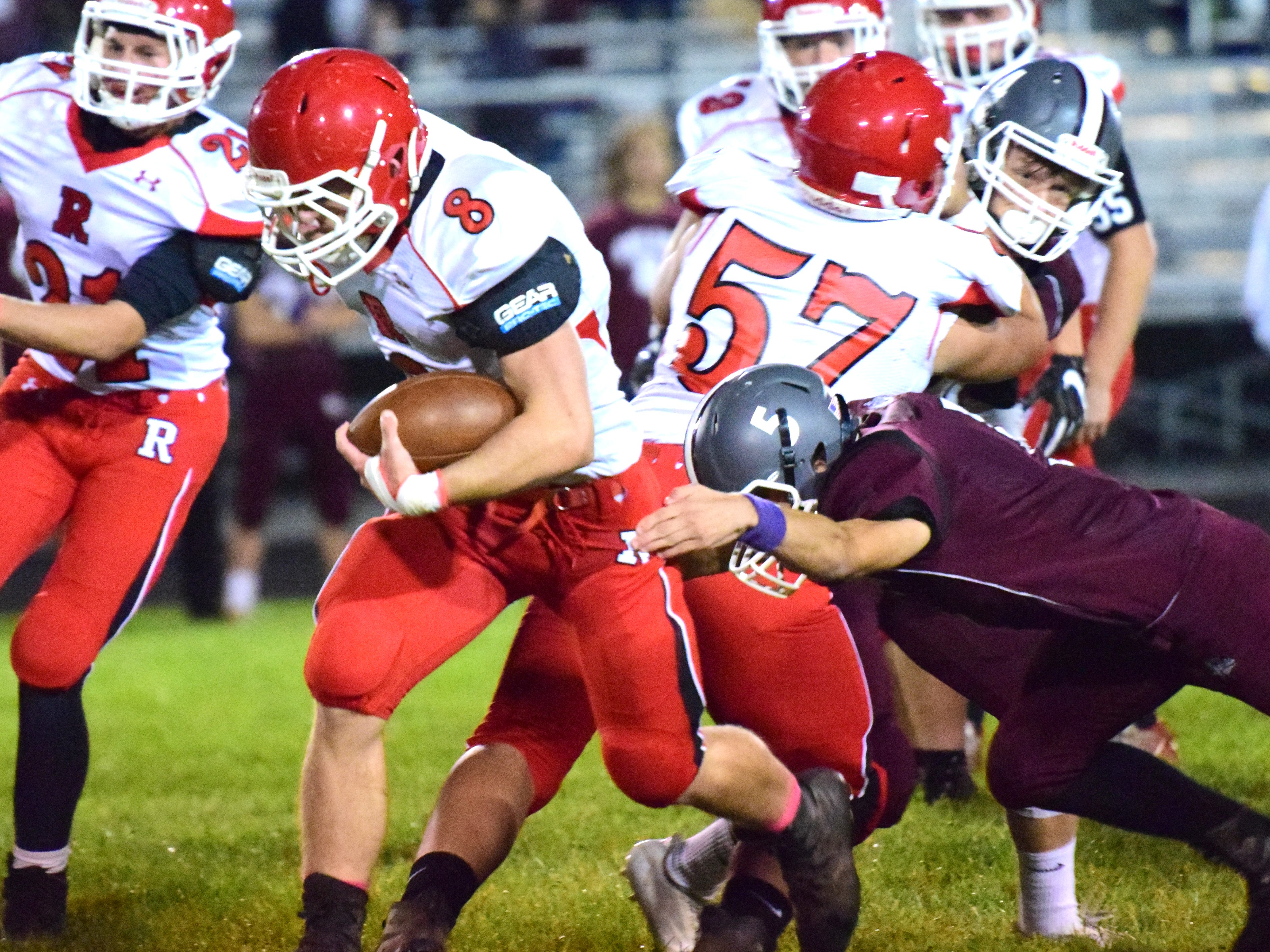 Riverheads' Zac Smiley plows through a Luray defender for extra yardage during the Gladiators' 56-13 victory Friday over the Bulldogs. It was Riverheads' fourth straight win and has them in the top spot in the Class 1 power point raitings this week.