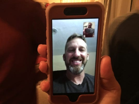 Kevin Jones is working in Pakistan for a year, but stays in touch with his family through WhatsApp, a messenger app for a smartphone.
