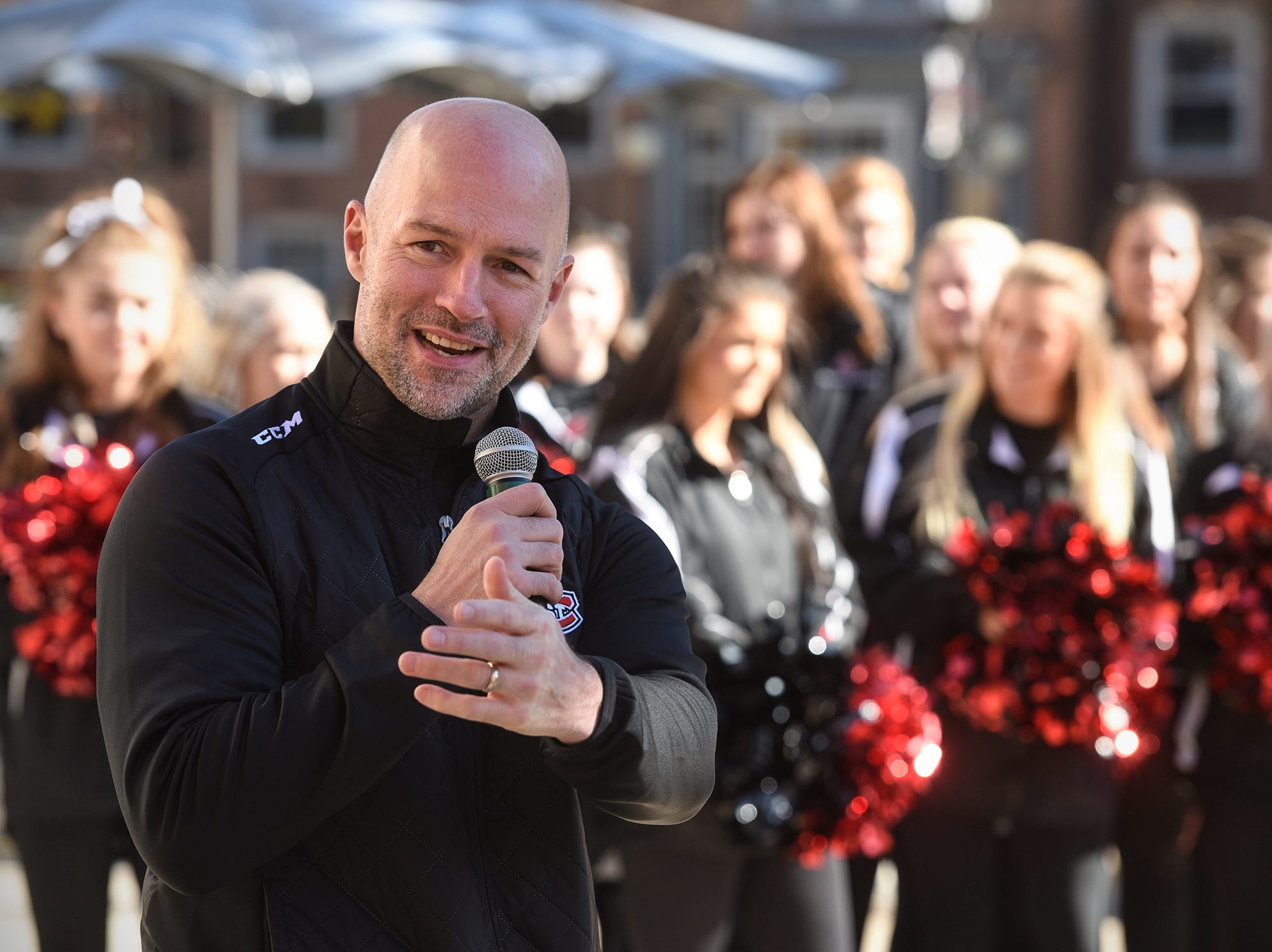 St. Cloud State men's hockey coach Brett Larson speaks during homecoming kick-off activities Wednesday, Oct. 17, at St. Cloud State University's Atwood Memorial Center Mall.