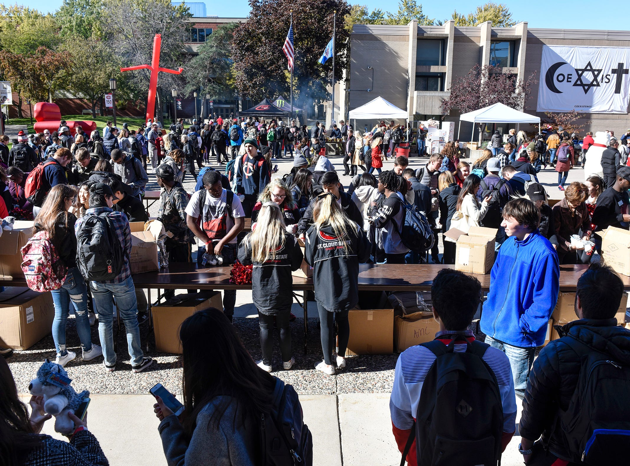 Students fill the Atwood Memorial Center Mall for homecoming kick-off activities Wednesday.
