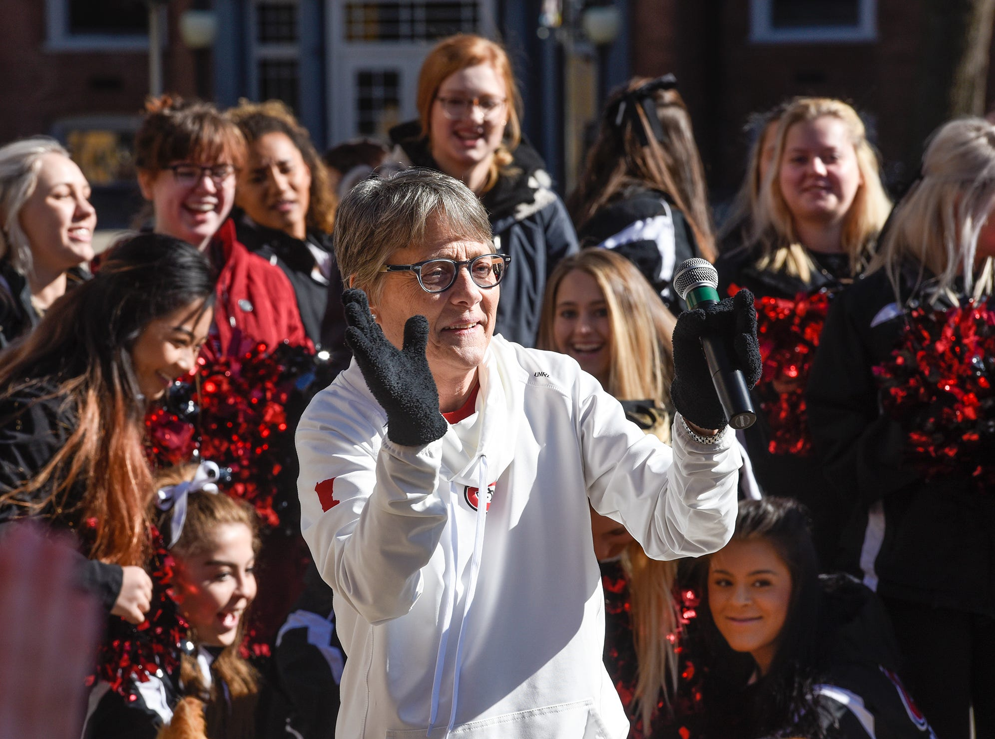 St. Cloud State University President Robbyn Wacker gets the crowd fired up during homecoming kick-off activities Wednesday, Oct. 17, at St. Cloud State University's Atwood Memorial Center Mall.