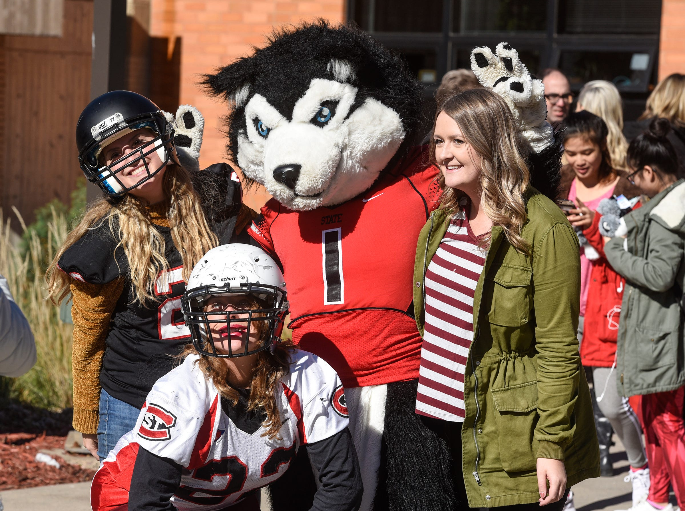 People pose for photographs with mascot Blizzard during homecoming kick-off activities Wednesday, Oct. 17, at St. Cloud State University's Atwood Memorial Center Mall.